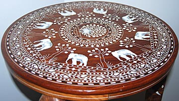 Judi Lund Wrote To Tell Me That She Has Not One But Two Ivory Inlaid Tables.  The First Has A Centered Peacock Surrounded By Elephants.